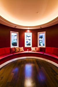 """Round architecture of a red """"chill out"""" room"""